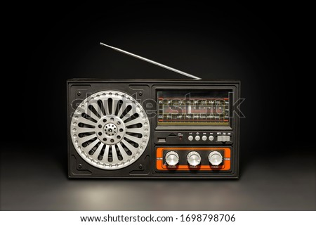 Retro radio receiver style on black background #1698798706
