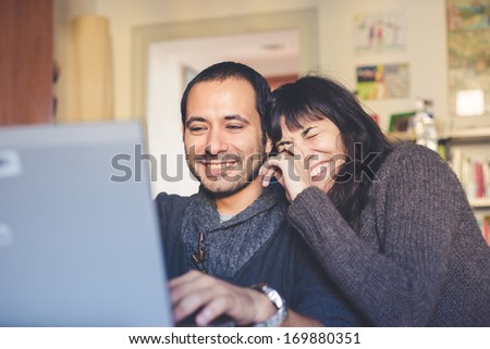 couple in love using notebook #169880351