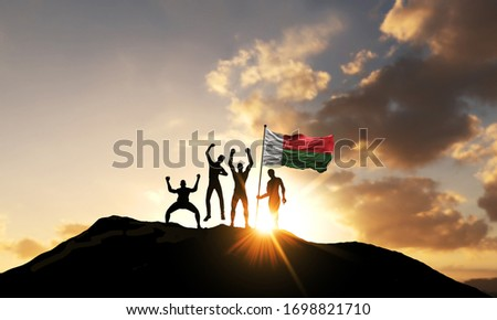A group of people celebrate on a mountain top with Madagascar flag. 3D Render #1698821710