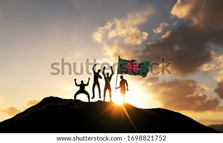 A group of people celebrate on a mountain top with Bangladesh flag. 3D Render #1698821752