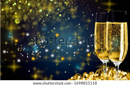 Two glasses of champagne with glitter lights bokeh  background #1698855118