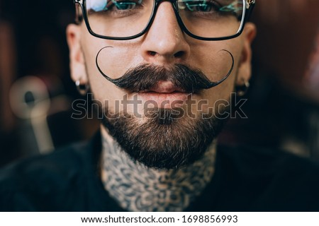 Well groomed hipster. Barbershop concept. Beauty industry. Facial hair care. Mature man bearded hipster with long beard and mustache. Styling mustache. Growing long mustache. Moustache style. Royalty-Free Stock Photo #1698856993