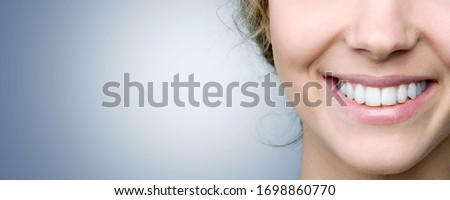 Beautiful smile of young woman with healthy white teeth Royalty-Free Stock Photo #1698860770