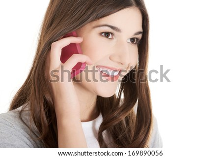 Young beautiful woman with phone. Isolated on white. #169890056