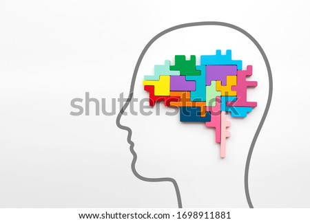 Logical brain concept. Brain made from omplex puzzle pieces in a human head #1698911881