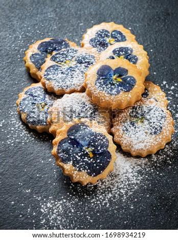 PANSY TOPPED SHORTBREAD COOKIES ON BLACK BACKGROUND #1698934219