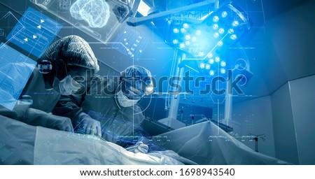 Operating room Doctor or Surgeon anatomy on Advanced robotic surgery machine futuristic virtual interface, robotic surgery are precision, miniaturisation future of tomorrow healthcare and wellness #1698943540