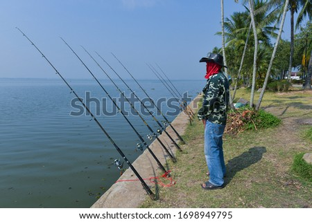 Angler Fishing adventures, carp fishing. Angler is fishing with carp fishing technique in freshwater, in a beautiful summer day #1698949795