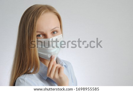 woman with medical mask. portrait of blonde girl. virus and health protection poster concept #1698955585