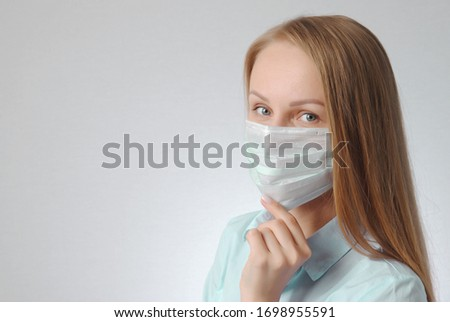 woman with medical mask. portrait of blonde girl. virus and health protection poster concept #1698955591