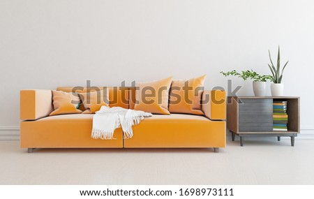 White minimalist living room interior with orange velveteen sofa, dresser on a wooden floor, decor on a large wall, white landscape in window. Home nordic interior. 3D illustration #1698973111