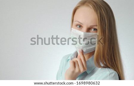 girl with medical mask. portrait of young woman. health protection poster concept #1698980632