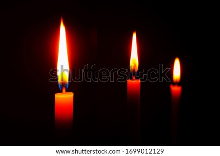 lighting candles, Burning candle on black background, Candle in hand, Candle in the dark, Design for the background. The light of the yellow stick candle in the dark at night. #1699012129