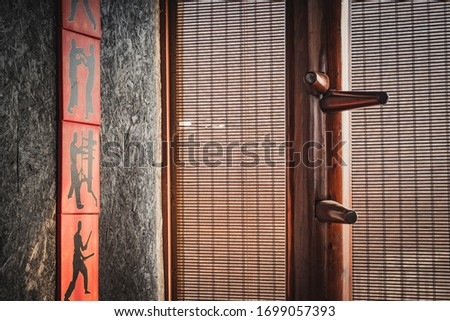 wing chun wooden dummy isolated background Royalty-Free Stock Photo #1699057393