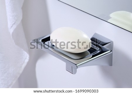 Metal soap dish on wall Royalty-Free Stock Photo #1699090303