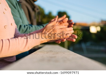 Family clapping from home to thank people fighting against coronavirus (covid19) Royalty-Free Stock Photo #1699097971