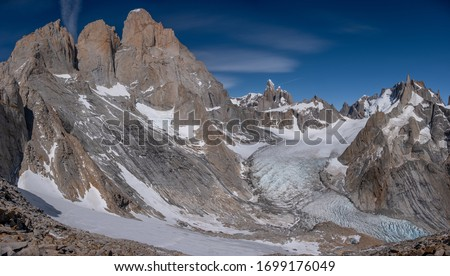 Panoramic view from Cuadrado passlocated near river Electrico, Argentina. From left to right - mountsGuillaumet, Mermoz,Fitz Roy with its northern glacier, mount Torre and mount Aguja Pollone. #1699176049