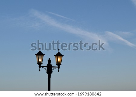 Traditional Black Iron Lamp Post against Blue Evening Sky  #1699180642