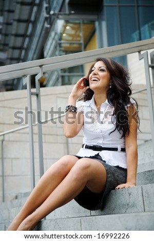 A beautiful hispanic businesswoman talking on the phone #16992226