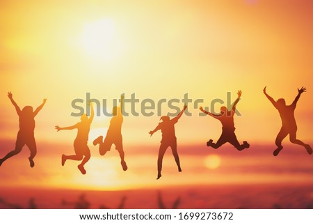 Happy friend jumping at tropical sunset beach background. Copy space of friendship freedom vacation and travel holiday teamwork concept. Vintage tone filter effect color style. #1699273672