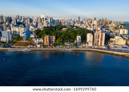 SALVADOR, BAHIA, BRAZIL -APR 8, 2020: Aerial Cityscape View of Barra by the lighthouse #1699299760
