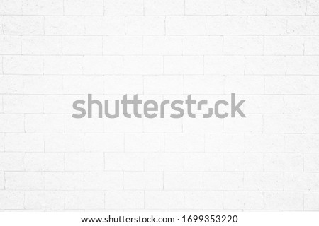 Wall white brick wall texture background in room at subway. Brickwork stonework interior, rock old clean concrete grid uneven abstract weathered bricks tile design, horizontal architecture wallpaper.