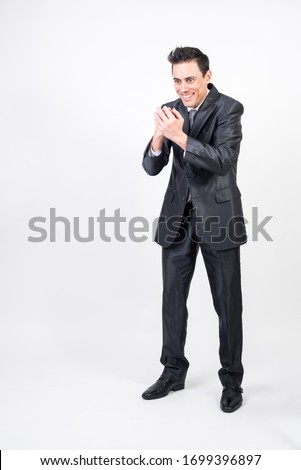 Evil man in suit machining a devilish plan. Full body, white background #1699396897