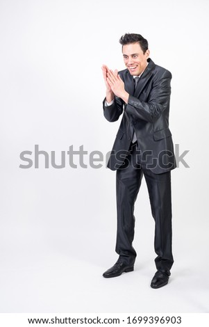 Evil man in suit machining a devilish plan. Full body, white background #1699396903