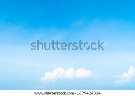 Beautiful white clouds on blue sky ,clouds on horizon , abstract sky for background. #1699424314