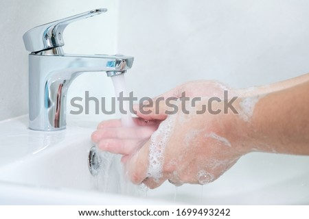 washing hands with soap sanitizer. wash movement.   #1699493242