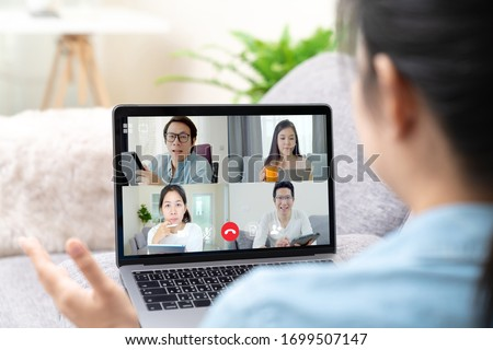 Group of young happy asian work from home meeting or brainstorming online video conference application on 5G internet with covid coronavirus business continuity plan via tablet or notebook computer. #1699507147