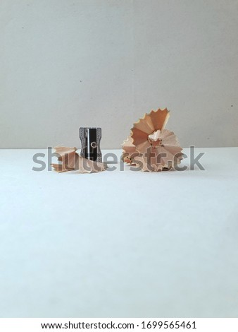 Pencil sharpener with pencil residue. Concept of work, effort, result, preparation, success, improvement. Background image for creative topics, brainstorming, business, education and learning.