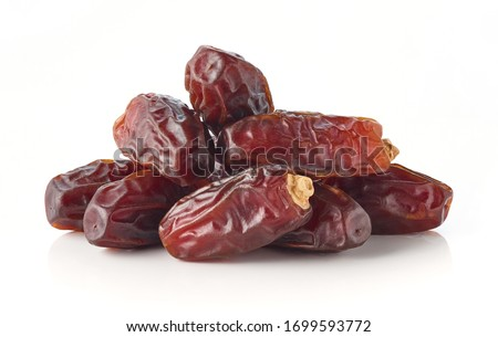 Heap of dates isolated on white background Royalty-Free Stock Photo #1699593772