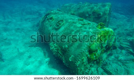 Wrecks deep in the ocean. Underwater archaeological remains Royalty-Free Stock Photo #1699626109
