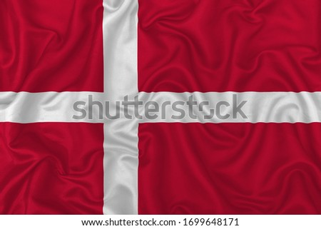 Denmark country flag on wavy silk textile fabric background. 3D Illustration. #1699648171
