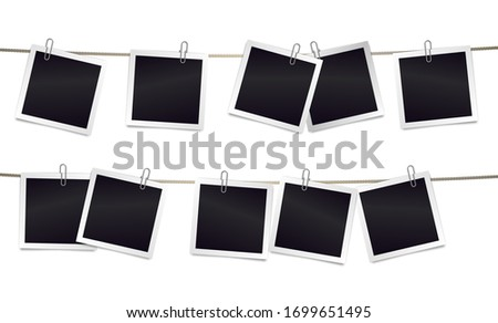 Square photorealistic blank retro photo frames attached metal paper clips on tapes. Template for design.