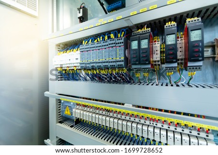 Electric control panel enclosure for power and distribution electricity. Uninterrupted, electrical voltage. Royalty-Free Stock Photo #1699728652