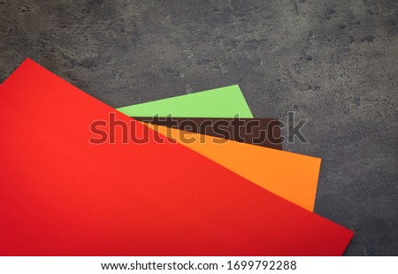 colored paper on a dark gray background #1699792288