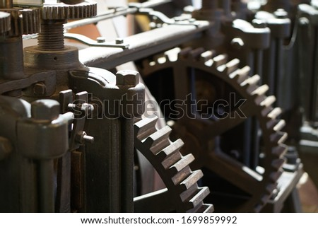 Close-up of a mechanic steel clockwork, showing rotating gear wheels and crankshaft. Picture taken of the ancient money press in the historic Casa da Moneda in Potosi, Bolivia