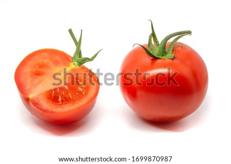 bright whole and cut tomatos isolated on white background whith little shadow #1699870987