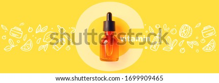 Glass bottle cosmetics, serums and oils with vitamin C on yellow background Image with Doodle style icons image Organic bio cosmetics Concept of protecting immunity during viral infection