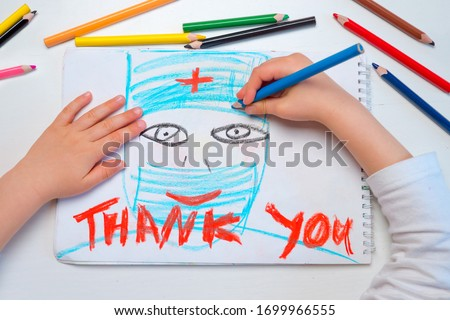Thank you hospital workers. Coronavirus doctors thank you. Child sends message of gratitude thanks to doctors and nurses. Symbol of hope during Covid-19 outbreak. Healthcare workers #1699966555