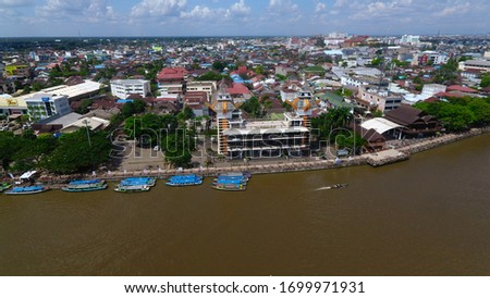 Banjarmasin, Indonesia - July 9, 2019: Aerial View of Menara Pandang The Landmark and Icon of Banjarmasin City #1699971931