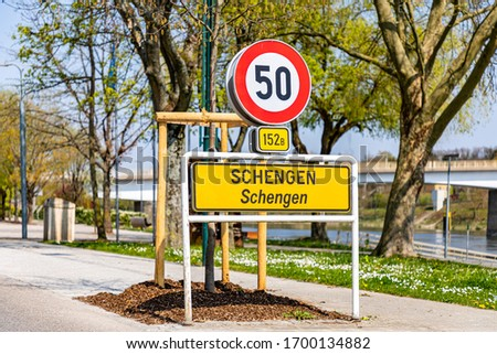 Yellow entrance road sign for Schengen town on the western bank of the river Moselle, Luxembourg. Birthplace of Schengen Agreement, common visa policy, which abolished passport and border control.