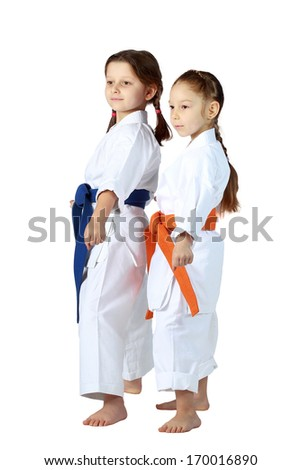 Girls athletes with orange and blue belt stand in rack #170016890