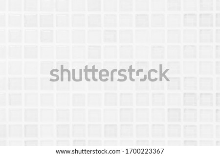 White or gray ceramic wall and floor tiles abstract background. Design geometric mosaic texture decoration of the bedroom. Simple seamless pattern for backdrop hospital wall, canteen and grid paper.
