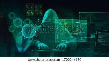 hacker virus malware  attack  during coronavirus pandemic  concept #1700246950