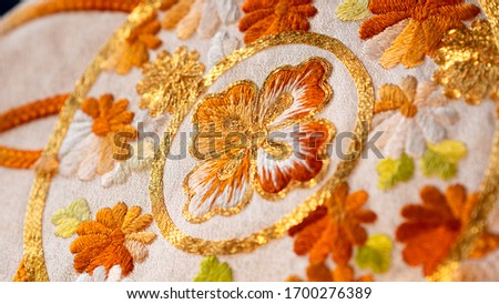 Macro close up on Japan traditional clothing kimono with beautiful embroidered pattern  Royalty-Free Stock Photo #1700276389