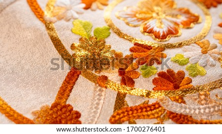 Macro close up on Japan traditional clothing kimono with beautiful embroidered pattern  Royalty-Free Stock Photo #1700276401
