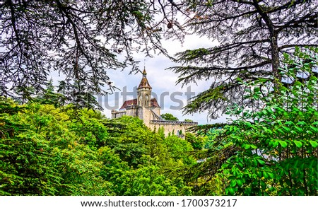 Castle tower in forest. Forest castle landscape. Castle forest view #1700373217